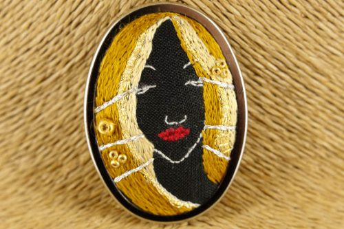 golden princess brooch