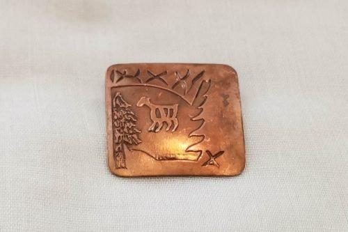 copper brooch