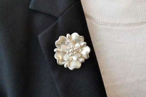 White yorkshire rose brooch.