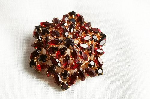garnet glass brooch